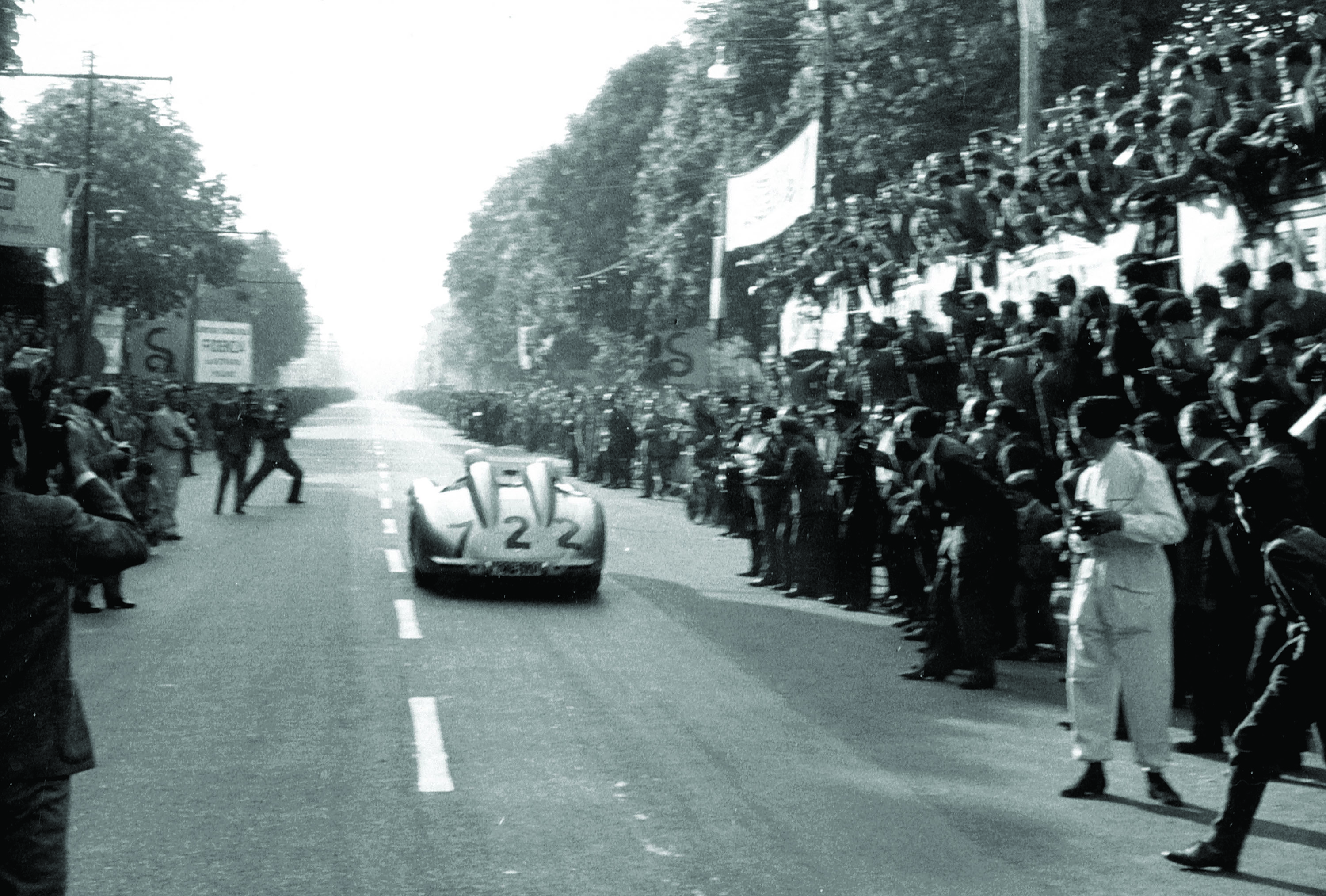 The Moss/Jenkinson Mercedes races past spectators at 1955 Mille Miglia Italy