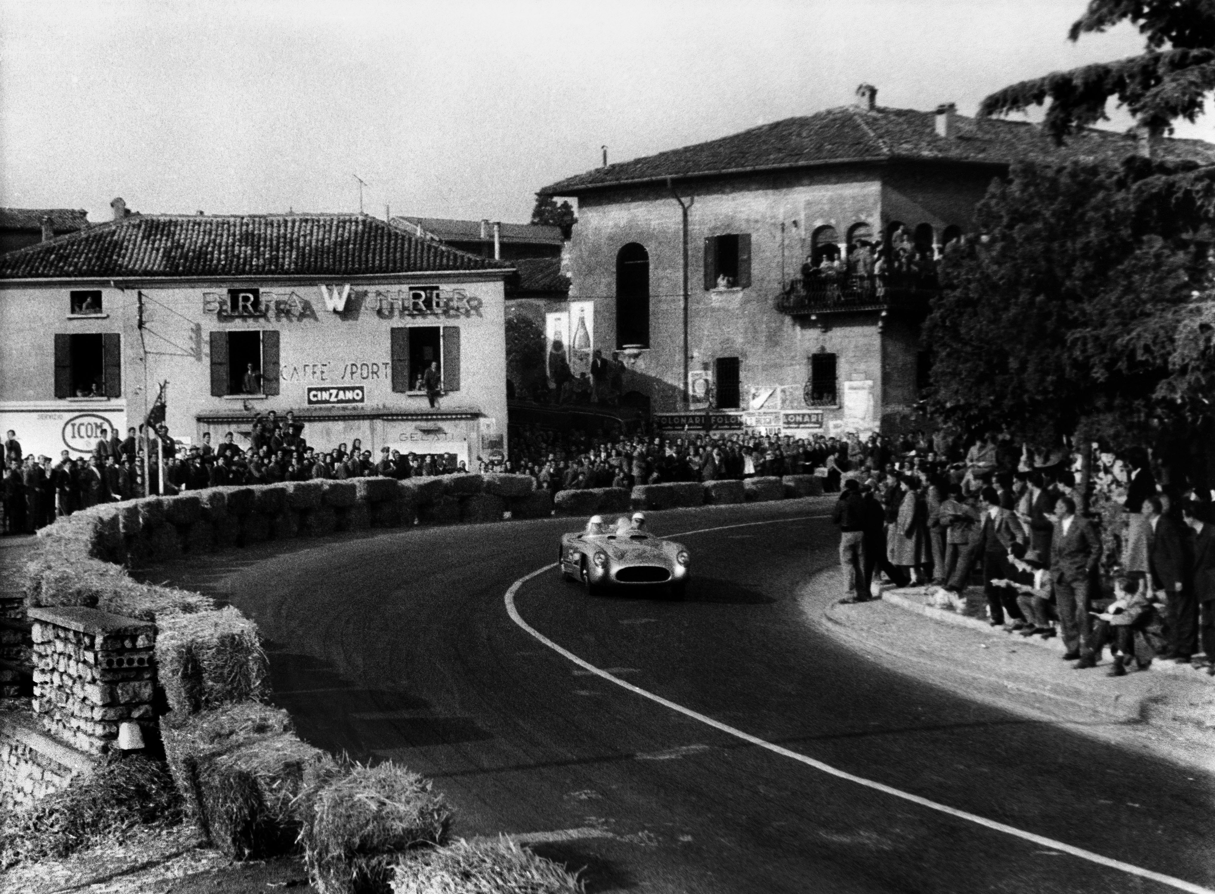 Stirling Moss and Denis Jenkinson race through another Italian town 1955 Mille Miglia Italy