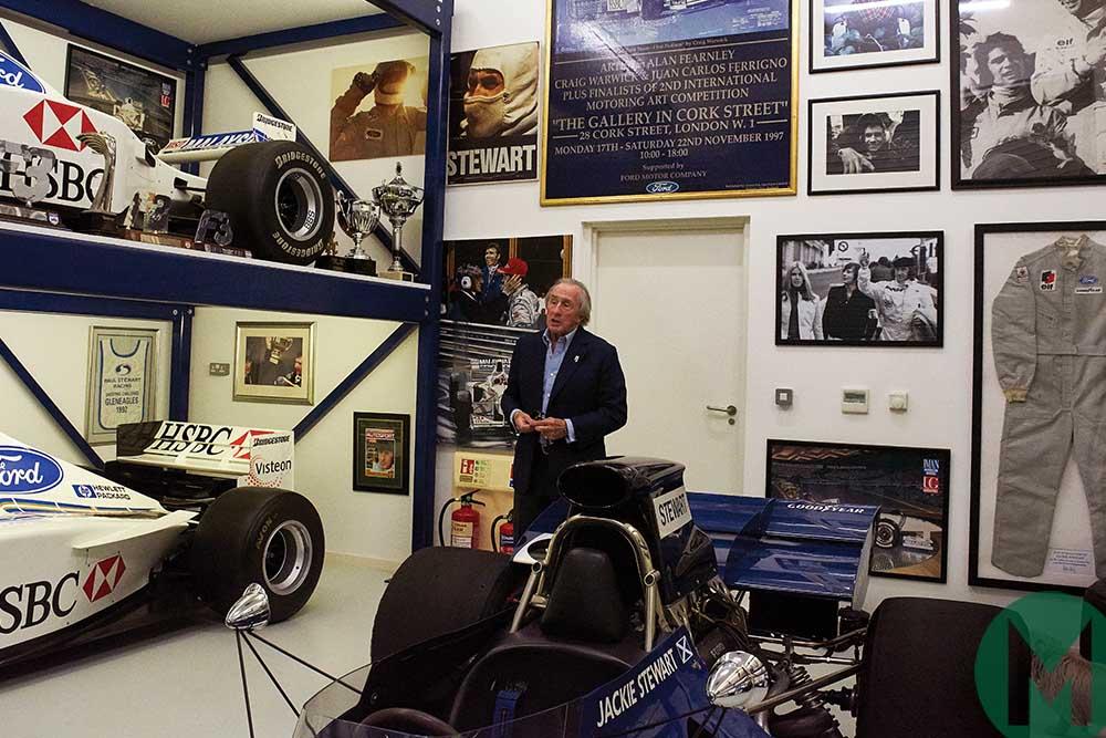 Jackie Stewart with memorabilia from his career