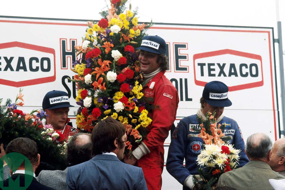 Gunnar Nilsson on the podium in 1977 Belgian Grand Prix