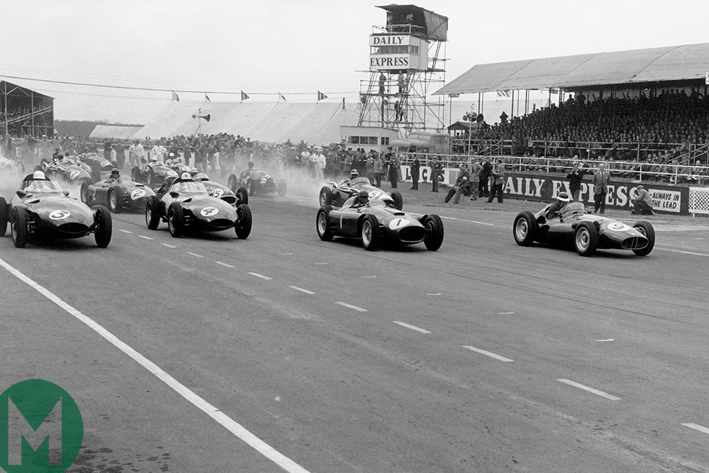 Stirling Moss leads at the start of the 1956 British Grand Prix