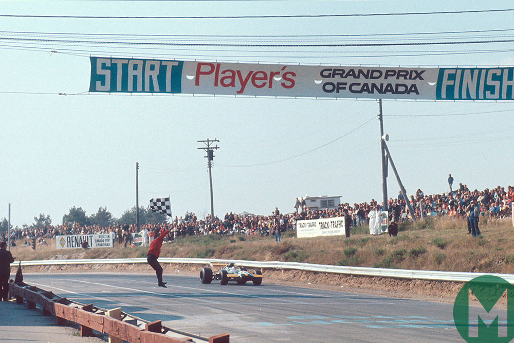 Jacky Ickx takes the 1969 Canadian GP chequered flag in this very BT26 chassis