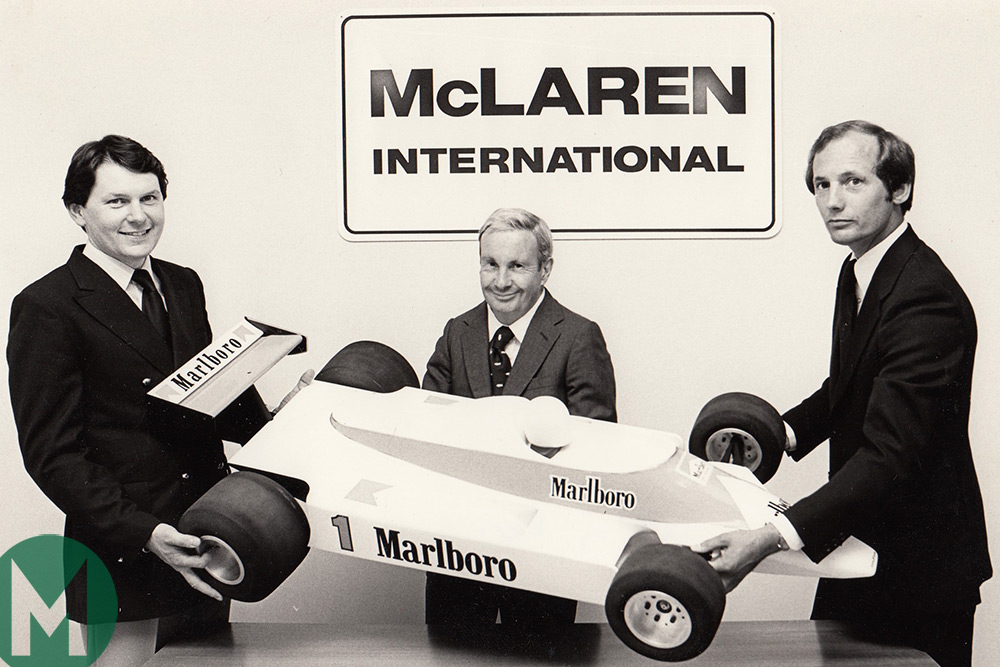 John Barnard and Ron Dennis present a model of the McLaren MP4/1