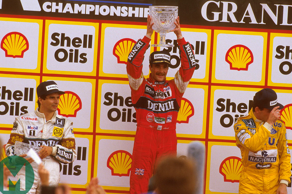 Nigel Mansell celebrates on the podium for the 1987 British Grand Prix with Nelson Piquet and Ayrton Senna