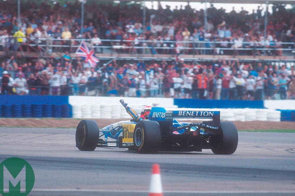 Johnny Herbert celebrates victory in the 1995 British GP