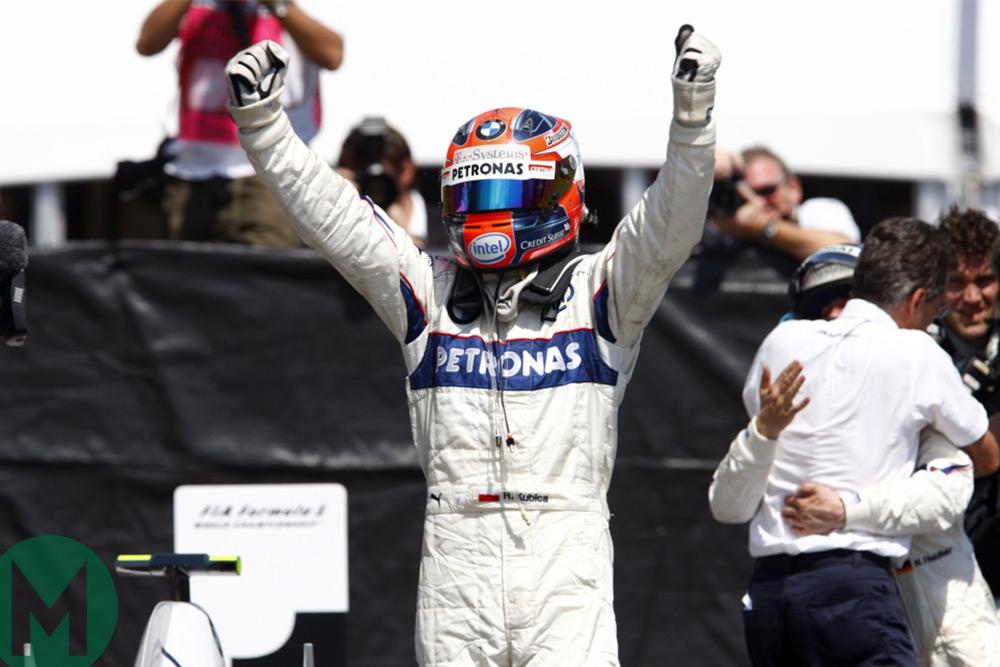 Robert Kubica celebrates his maiden Grand Prix win