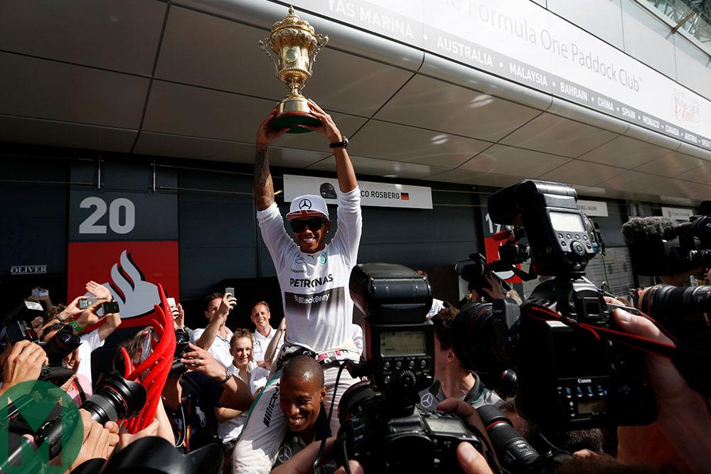 Lewis Hamilton raises his trophy after winning the 2014 British Grand Prix