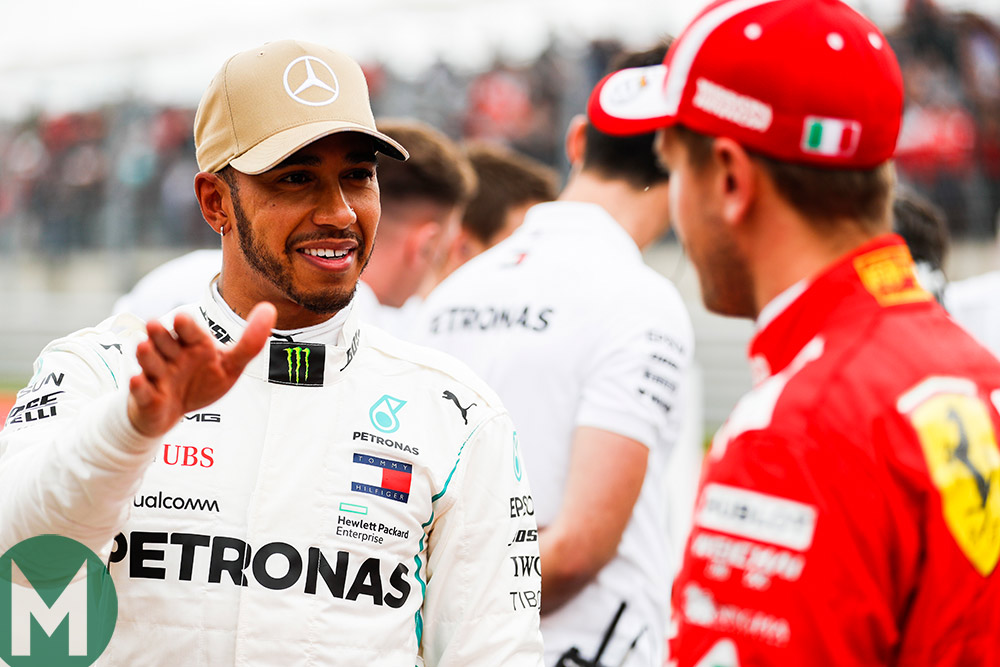 Lewis Hamilton chats with Sebastian Vettel