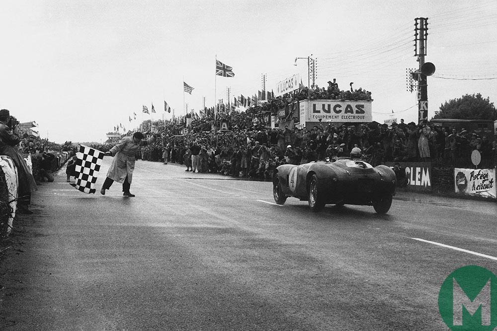 Trintignant and Gonzalez's Ferrari 375 Plus crosses the line to win 1954's Le Mans 24 Hour race