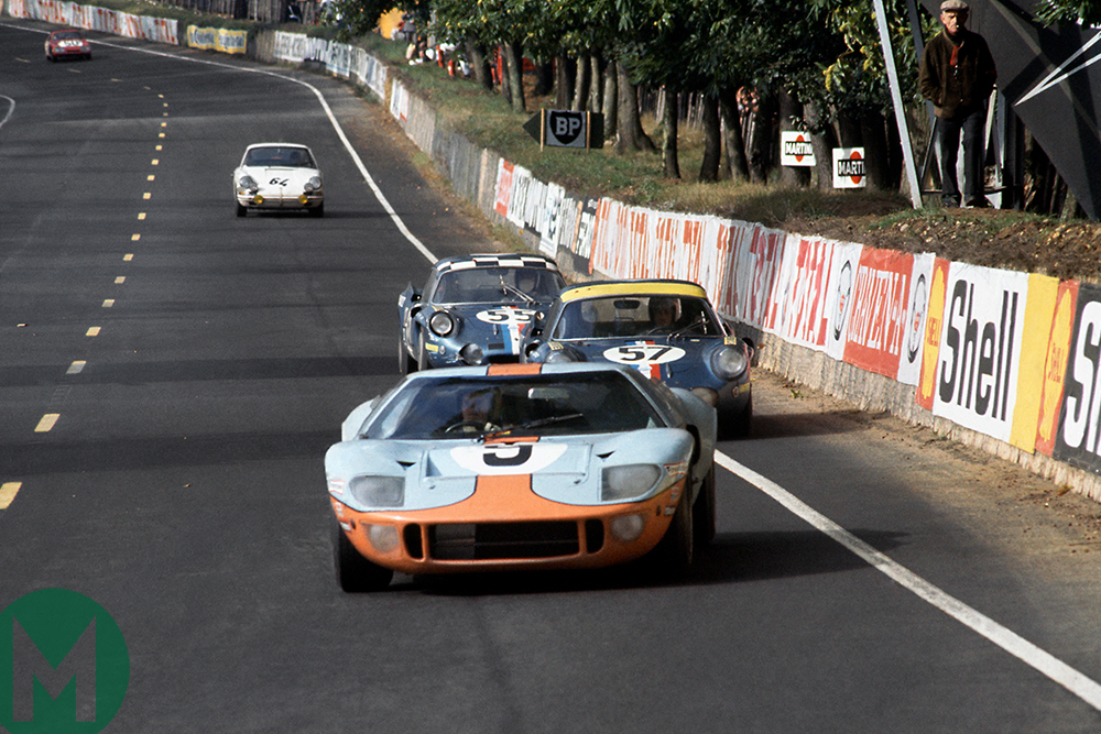 Pedro Rodríguez in a Ford GT40 leads a train of trains in 1968's Le Mans