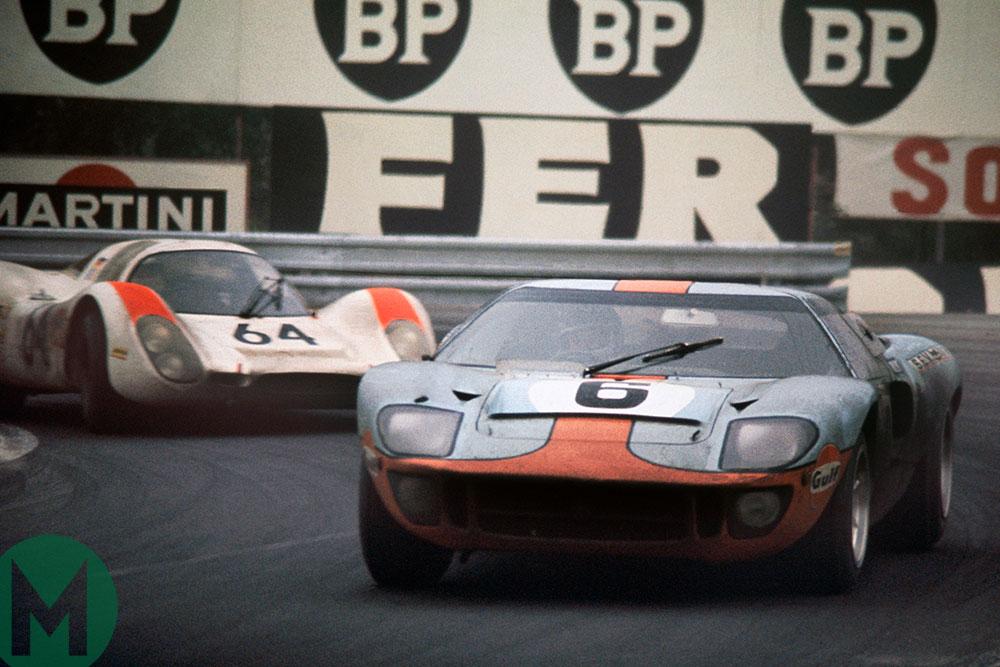 Jacky Ickx/Jackie Oliver's Ford GT40 leads Hans Herrmann/Gérard Larrousse's Porsche 908 at the 1969 Le Mans 24 Hours