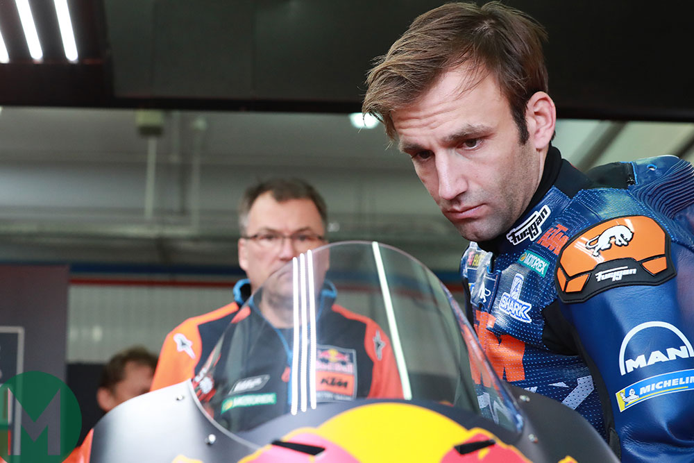 Johann Zarco inspects his new Red Bull KTM Factory Racing machine