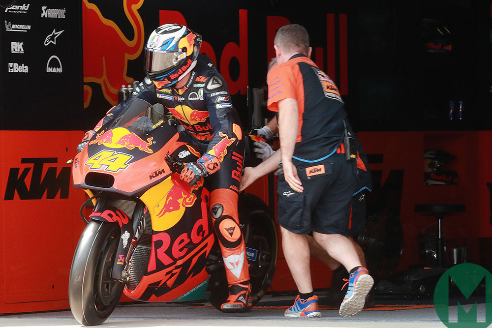 Pol Espargaro on the KTM exits his pit garage