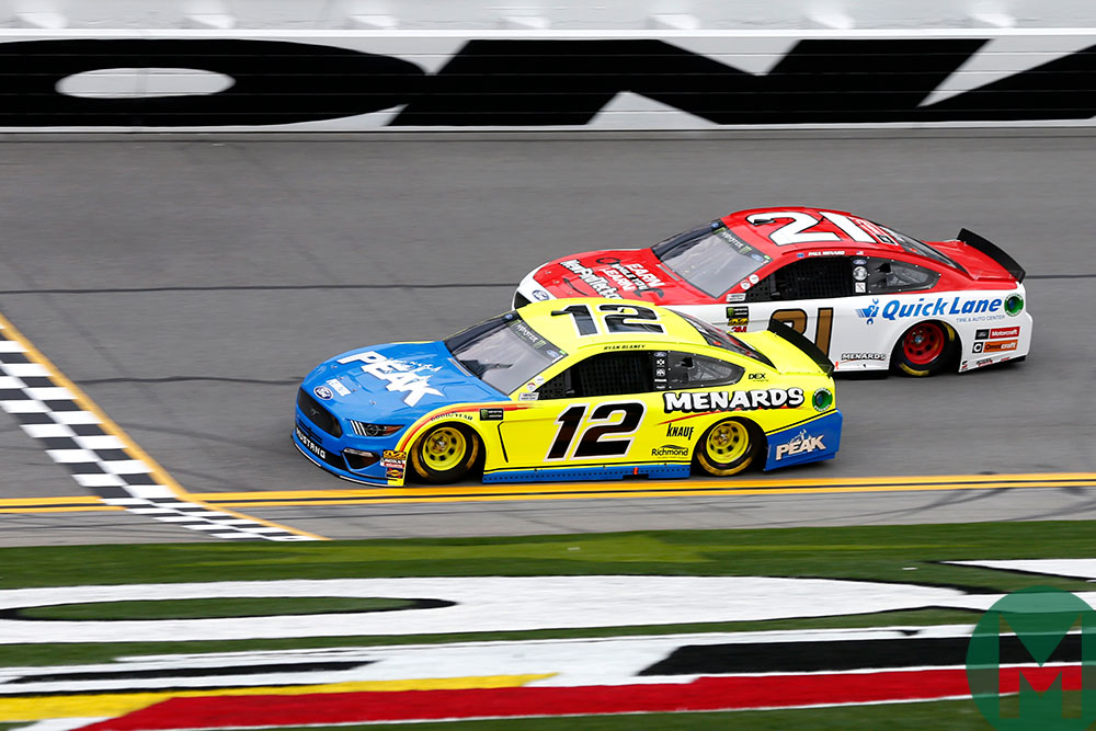Ryan Blaney and Paul Menard, both in Mustangs, race at Daytona in 2019