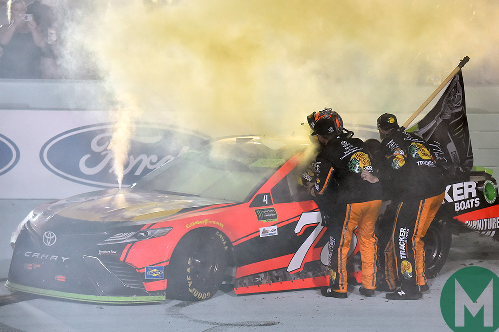 Martin Truex Jr celebrates his NASCAR Cup win