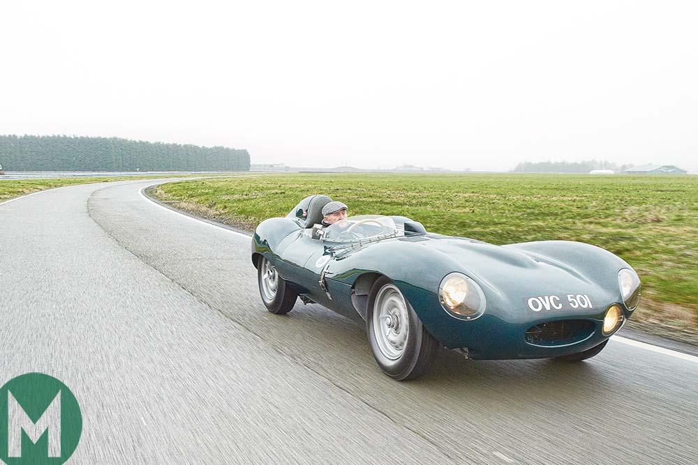 Norman Dewis driving a Jaguar D-type