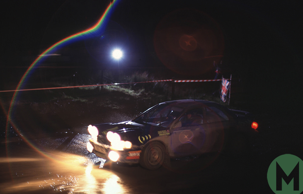 Colin McRae in his Subaru at night