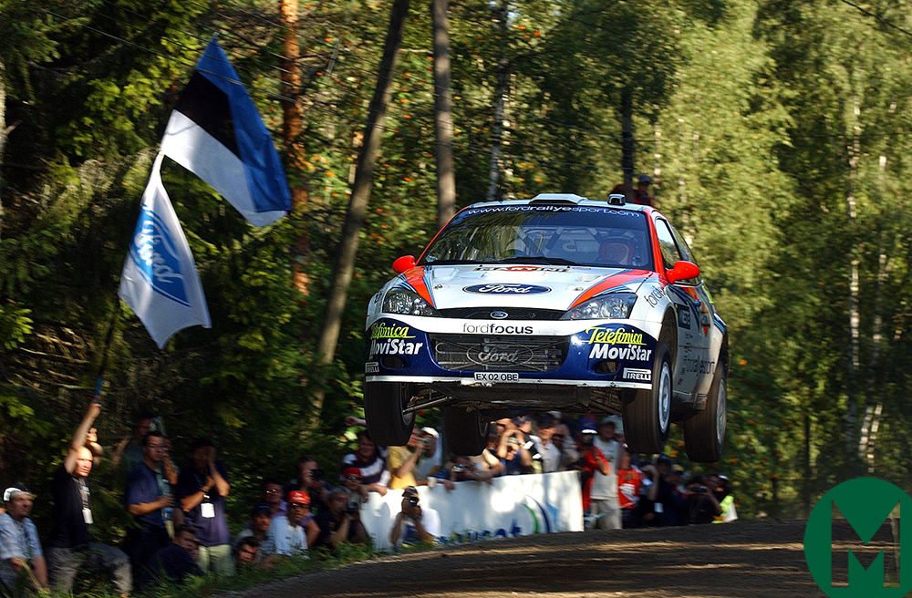 Colin McRae takes some air in his Ford in 2002