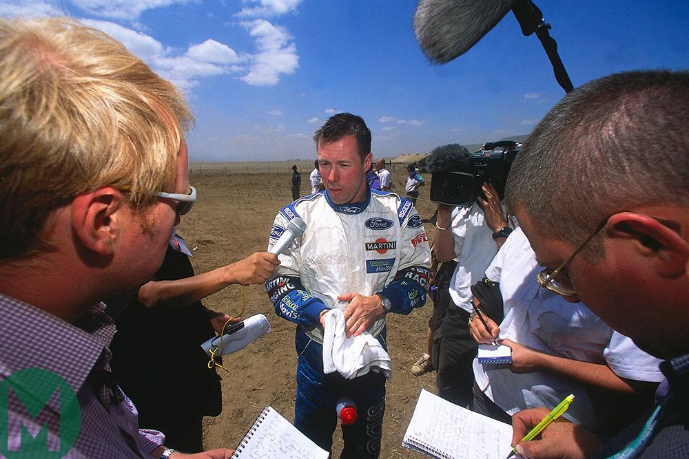 Colin McRae deals with the press in the 2002 Safari Rally