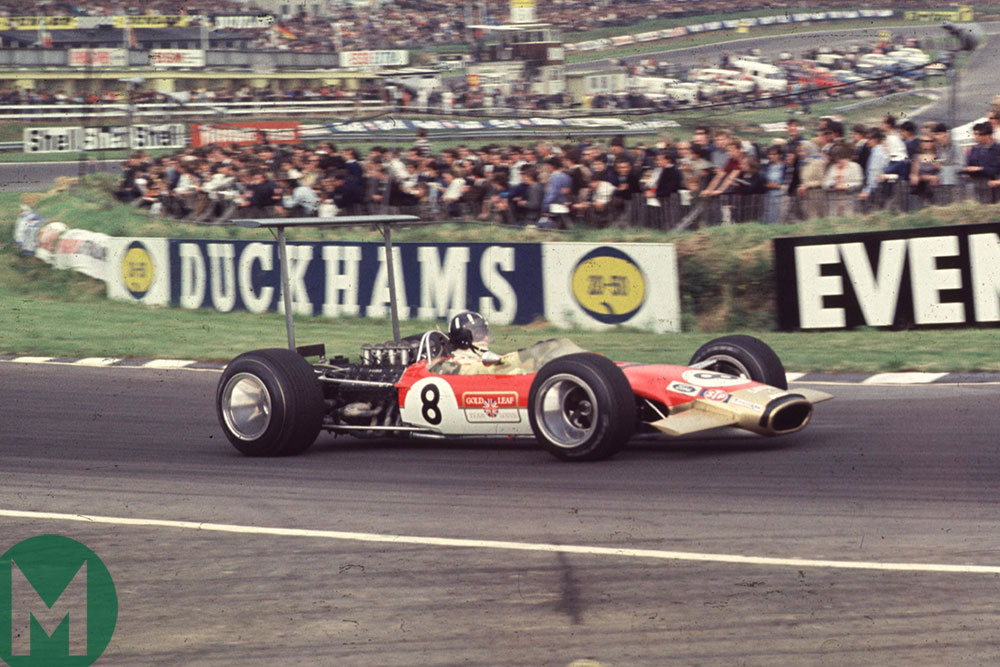 Graham Hill in the 1968 British Grand Prix - with a Union flag rather than a Sailor Boy