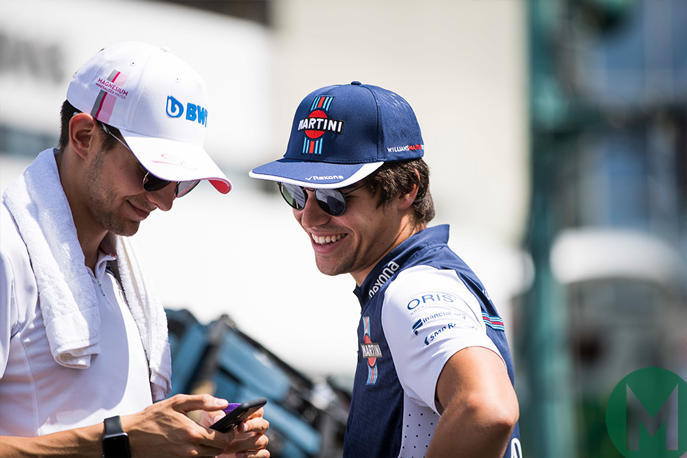 Stroll, Williams, chats with Force India's Esteban Ocon, who he is expected to replace